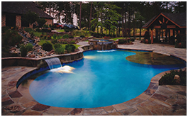 Custom pools built by CCH Pools, a custom pool builder, in Longview, Tx with stone work and water features