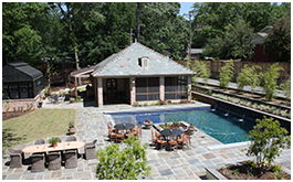 Custom Pool house built by CCH Pools in Longview Texas, stone courtyard with a four column pool house