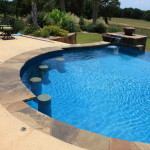 Round Pool with pool side underwater stone bar stools, infinity edge pool