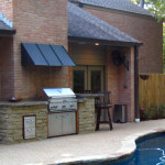 Outdoor Kitchen with stainless steel grille and small overhang