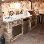 stainless steel outdoor kitchen with wrought iron bar stools