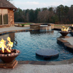 2 fire features with central blue tiled table top in pool