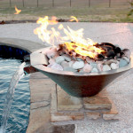 pool side stone fire feature with water spout