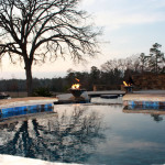 blue tiled pool with fire accents