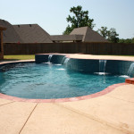 curved edge pool with water features