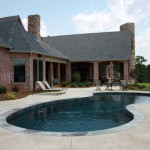 round edge pool with seating area