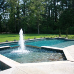 pentagon shaped spa with rectangular pool with central water fountain