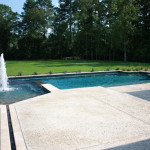 custom pool with water channel feeding spa and pool with fountain