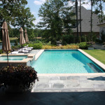 light blue pool with chaise lounge chairs and upper deck spa