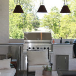 white outdoor kitchen with pendant lights