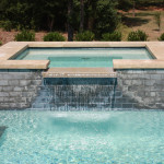 rectangular spa with overflow channel into pool