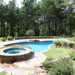 stone round hot tub custom built with pool
