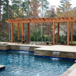 squared edge pool with flat water spouts and pergola