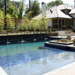 L-shaped pool with flat water spouts