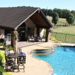 large pool house with patio