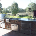 stainless steel outdoor kitchen with black granite counter top