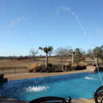 water spouts shooting out of pool edge into pool