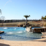 rounded pool with multiple fountains and infinity edge