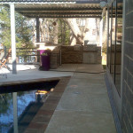 outdoor kitchen area off spa