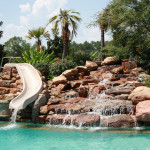 natural river rock waterfall with pool slide