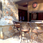 outdoor kitchen with bar top and pizza oven