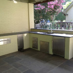 light colored painted brick outdoor kitchen with stainless steel appliances
