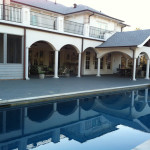 reflective pool with columned outdoor living space