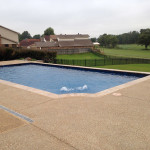 scalloped corner rectangular pool with fountains