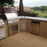L-shaped outdoor kitchen with stainless steel appliances