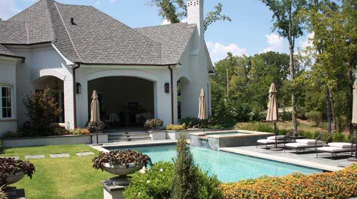 Beautiful white stone pool with outdoor living space built by CCH Pools of Longview Texas